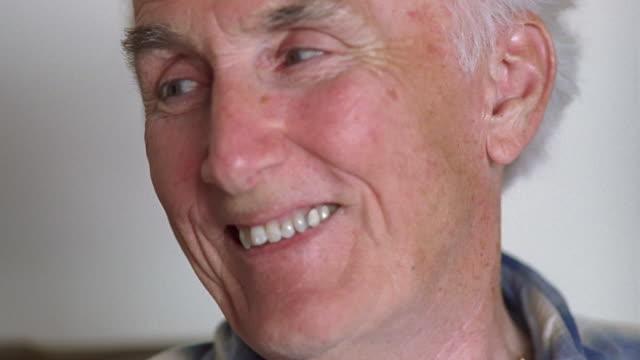 cu senior man looking away and smiling / washington state, usa - 年配の男性一人点の映像素材/bロール