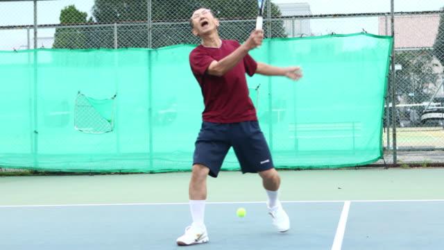 senior man making a mistake in tennis - match sport stock-videos und b-roll-filmmaterial
