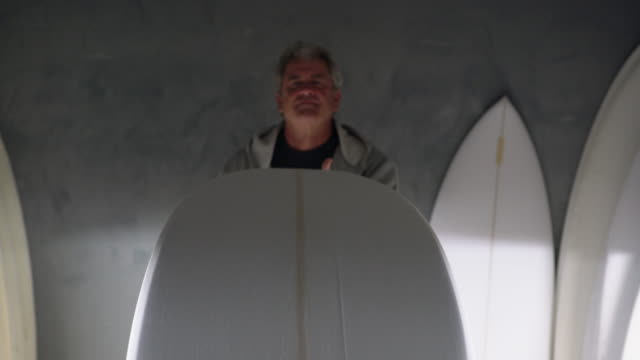 ms senior man making a surfboard in his workshop - surfboard stock videos & royalty-free footage