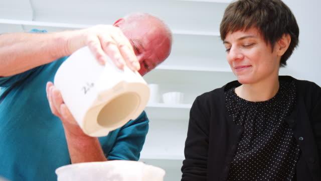 senior man making ceramic pots at pottery studio - moulding a shape stock videos & royalty-free footage
