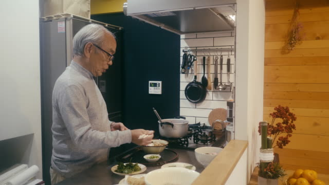 senior man making toshikoshi soba year-crossing noodles in the kitchen - seaweed stock videos & royalty-free footage