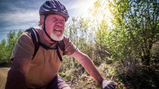 stockvideo's en b-roll-footage met senior man mountain biken in duitsland - 70 79 jaar