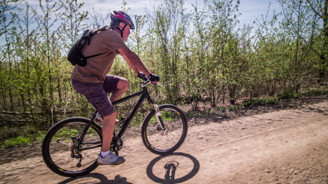 senior man mountain biking - mountain biking stock videos & royalty-free footage