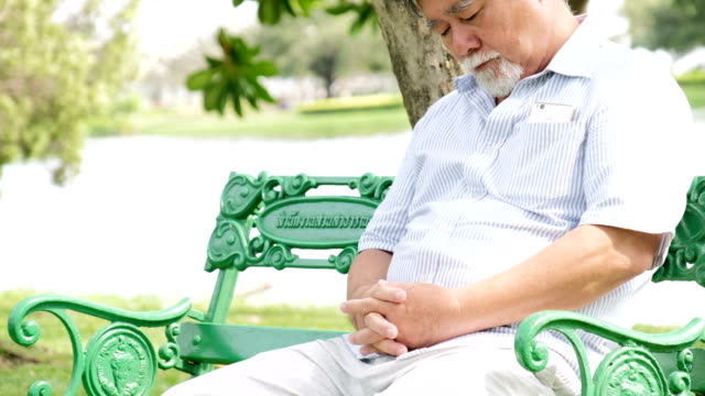 senior man napping on bench - bench stock videos & royalty-free footage