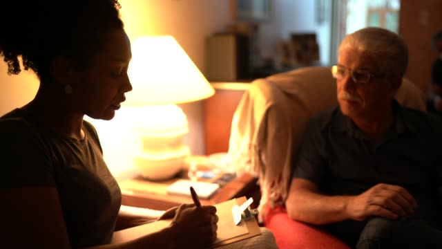 senior man on a meeting with counsellor at home - alternative therapy stock videos & royalty-free footage