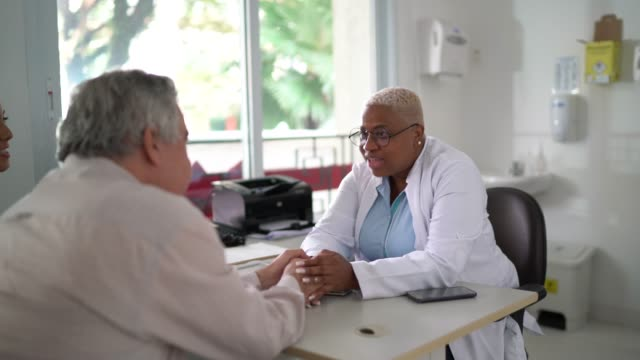 senior man on medical appointment - female doctor stock videos & royalty-free footage