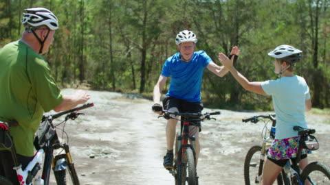 senior man on mountain bike - encouragement stock videos & royalty-free footage