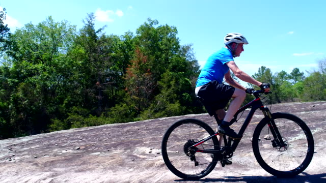 senior man on mountain bike - mountain biking stock videos & royalty-free footage