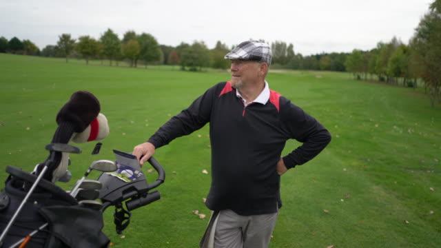 senior man on the golf course. - golf bag stock videos & royalty-free footage