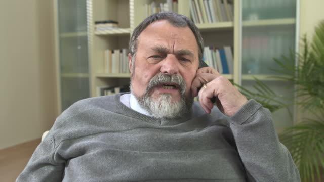 hd dolly: senior man on the phone - beard stock videos & royalty-free footage