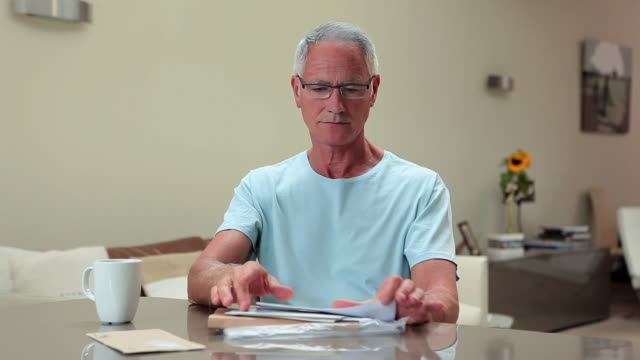 senior man opening and reading letter - reading mail stock videos & royalty-free footage