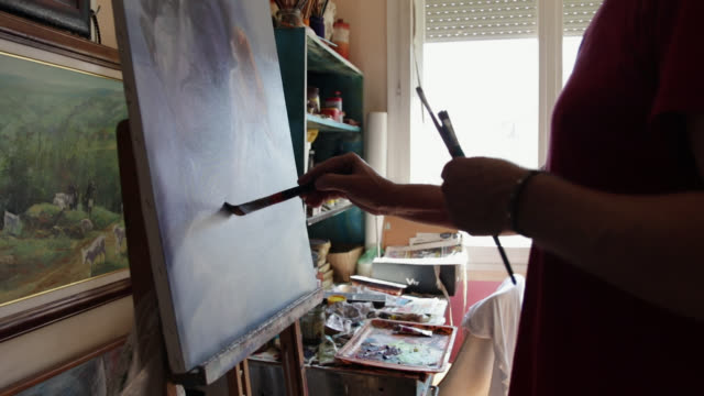 senior man painting in his art studio. talented senior man improving his hobbies every day - art class stock videos & royalty-free footage