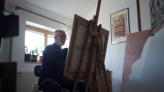 senior man painting in his workshop - paintings stock videos & royalty-free footage