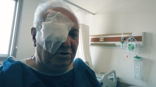 senior man patient had an eye lasik surgery - retina stock videos & royalty-free footage