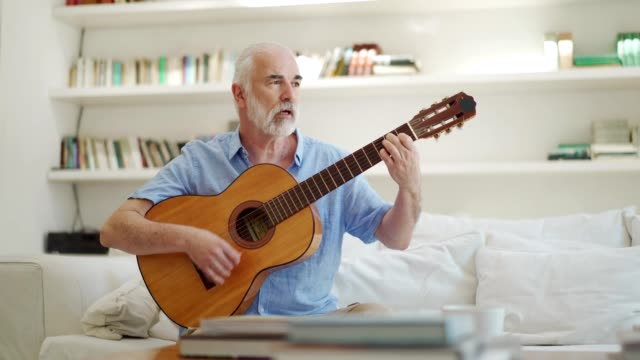 senior man playing acoustic guitar - guitar stock videos & royalty-free footage