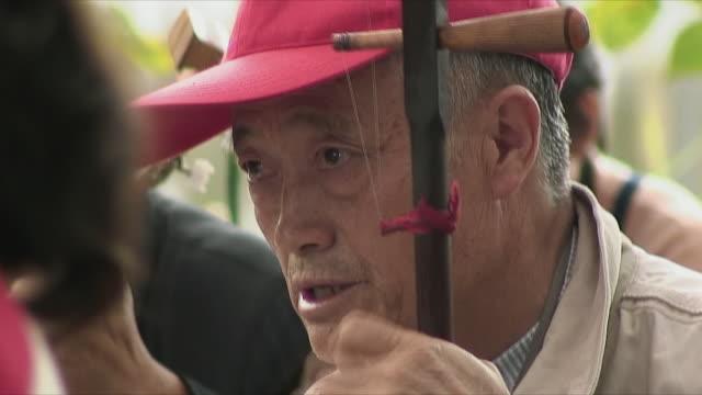 CU Senior man playing gaohu, Kunming, China