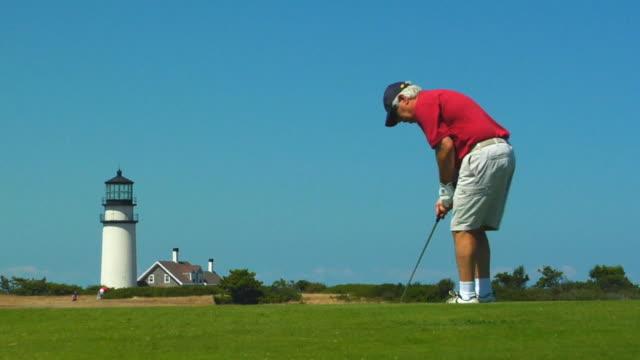 MS, Senior man playing golf, North Truro, Massachusetts, USA