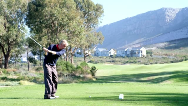 senior man playing golf - golf course stock videos & royalty-free footage