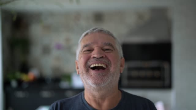 senior man portrait at home - sorridere video stock e b–roll
