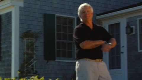 cu, pan, senior man posing in front of cottage, portrait, north truro, massachusetts, usa - in front of stock videos & royalty-free footage