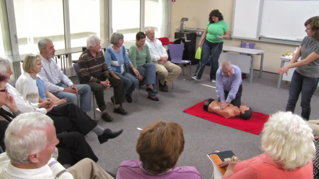 hd: senior man practicing cpr on a dummy - cpr stock videos & royalty-free footage