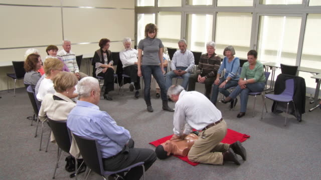 hd: senior man practicing cpr on a dummy - instructor stock videos & royalty-free footage