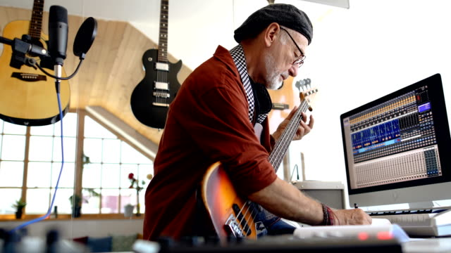 senior man practicing playing electric bass - rock musician stock videos & royalty-free footage
