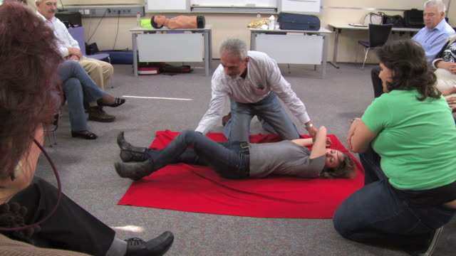 hd: senior man practicing the recovery position - first aid stock videos & royalty-free footage