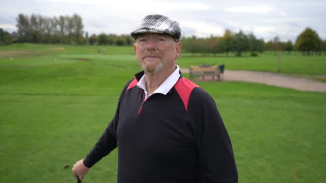 a senior man preparing to tee off. - golf club stock videos & royalty-free footage