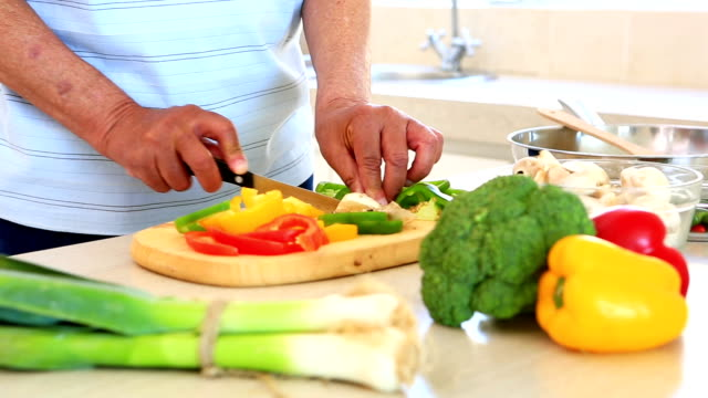 Senior man preparing vegetables for dinner