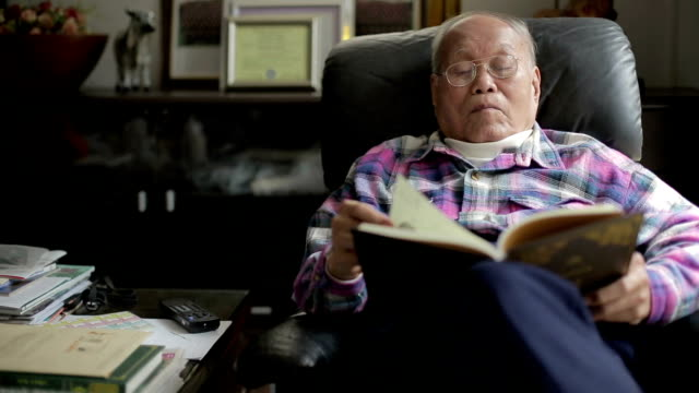 senior man reading a book - mack2happy stock videos and b-roll footage