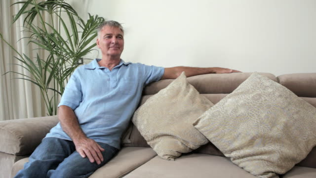 Senior man relaxing on sofa