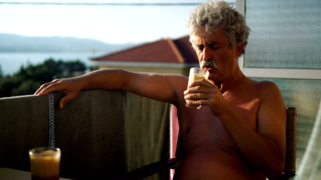senior man relaxing with coffee - moustache stock videos & royalty-free footage