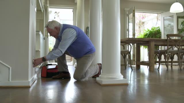 senior man repairing a socket - toolbox stock videos and b-roll footage