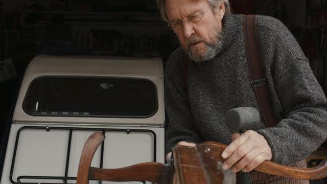 senior man repairing furniture - workbench stock videos & royalty-free footage