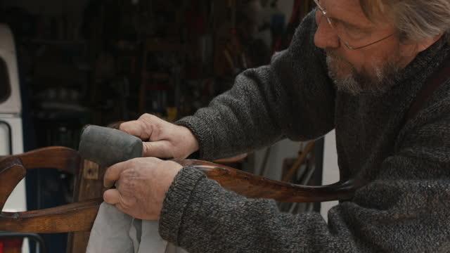 senior man restoring antique chair in garage workshop - workbench stock videos & royalty-free footage