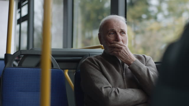 senior man riding on a bus - passenger stock videos & royalty-free footage