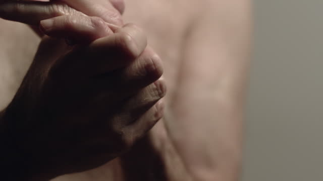 cu senior man rubbing hands / los angeles, california, usa - pain stock videos & royalty-free footage