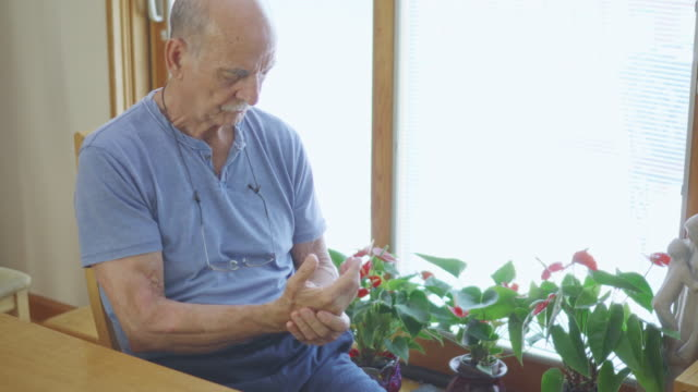 senior man rubbing his painful hands - cramp stock videos & royalty-free footage