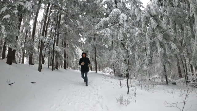 senior man running in beautiful winter forest - imgorthand stock videos & royalty-free footage