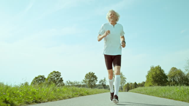 SLO MO TS Senior man running on a sunny day