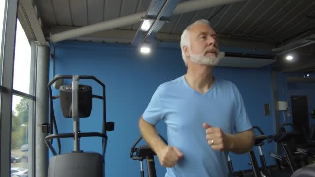 Senior man running on a treadmill