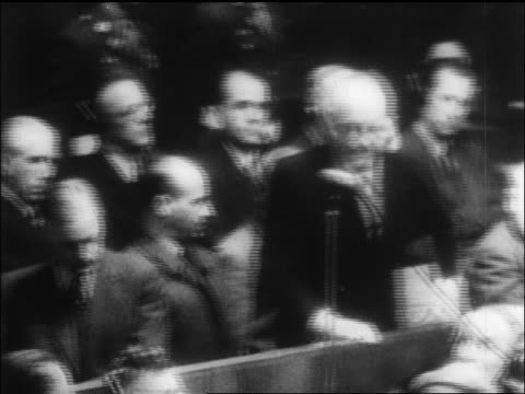 b/w 1946 senior man saying plea into microphone at war crimes trial / nuremberg / newsreel - war crimes trial stock videos and b-roll footage