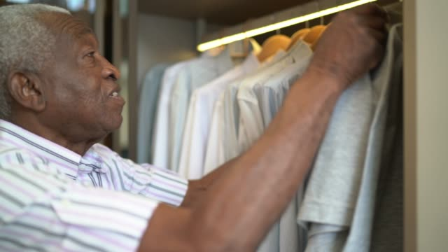 senior man selecting clothes at home - choice stock videos & royalty-free footage