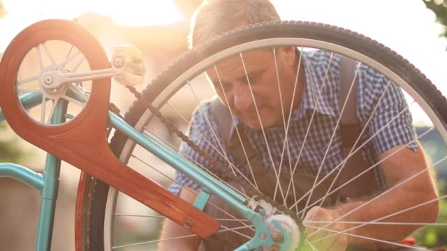 senior man serviced bikes - instructions stock videos & royalty-free footage