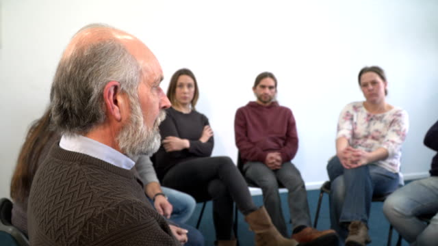 4K DOLLY: Senior Man sharing his story in Support Group therapy circle