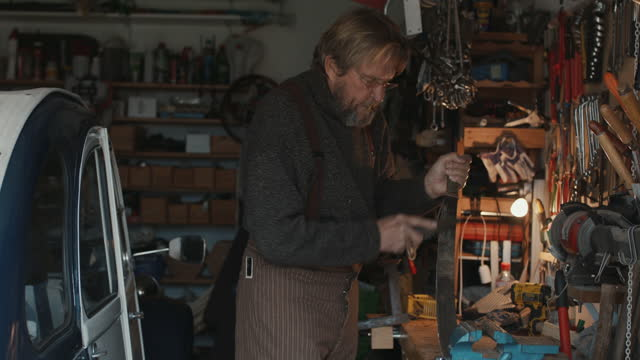 senior man sharpening machete in workshop - workbench stock videos & royalty-free footage