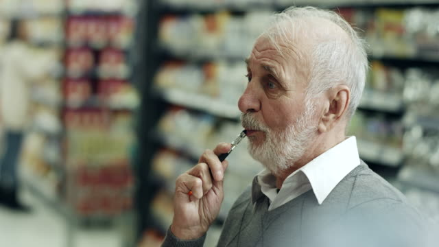 senior man shopping and vaping - nutrition label stock videos and b-roll footage