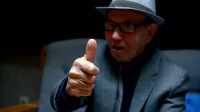 Senior man showing thumbs up