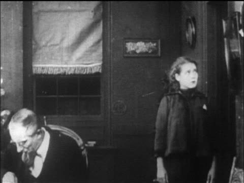B/W 1912 senior man (Charles Mailes) sits as girl (Mary Pickford) pouts